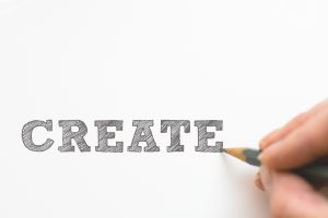 "Hand drawn font saying ""create"" for custom typography in Design Trends for 2019."